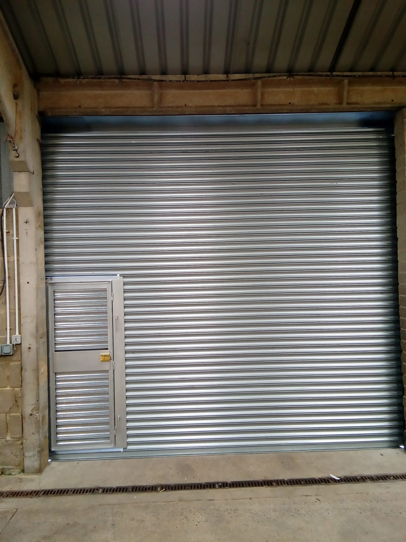 Roller-Shutter-With-Personnel-Door-Interior, Manchester
