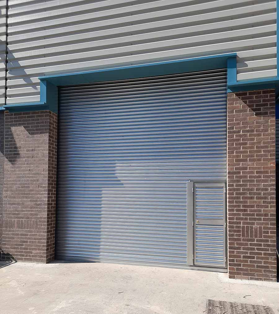 Industrial Warehouse Door With Personnell Door, West Yorkshire